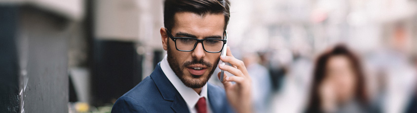 Picture of a businessman talking on a phone.