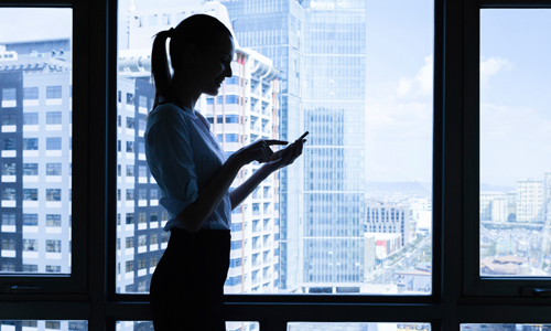 Image of a woman using telecommunications at work.